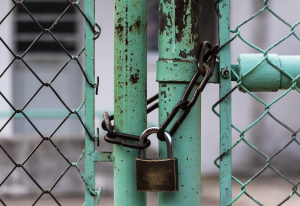a padlock holds a gate closed representing VR integration security