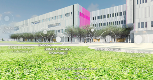 VR architecture image of the building when completed from outside on the lawn looking at a grey 3 story building with many windows